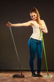 Funny cleaning woman mopping floor Stock Image