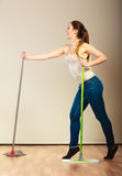 Funny cleaning woman mopping floor dancing Stock Photos
