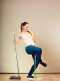 Funny cleaning woman mopping floor dancing Stock Photography