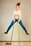 Funny cleaning woman mopping floor jumping Royalty Free Stock Photos