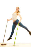 Funny cleaning woman mopping floor jumping Stock Photography