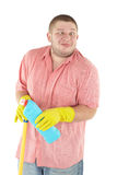 Funny cleanner with equipment. Picture of joyful cleaner. Isolated over white Stock Images