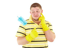 Funny cleanner with equipment. Picture of joyful  professional cleaner with yellow gloves. Iisolated over white Royalty Free Stock Image