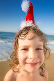 Funny closeup portrait of baby in Santa hat Royalty Free Stock Images