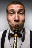 Funny closeup portrait of blowing saxophonist Royalty Free Stock Photos