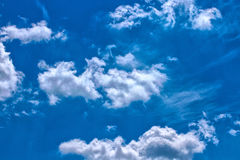 Funny clouds on blue sky Royalty Free Stock Images