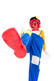 Funny clown. Clown smashing somethig with his foot (isolated on white Royalty Free Stock Photos