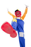 Funny clown. Clown smashing something with his foot (isolated on white Royalty Free Stock Photography