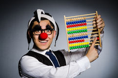 Funny clown with abacus. In accounting concept Royalty Free Stock Image