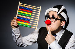 Funny clown with abacus Stock Photo