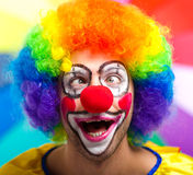 Funny clown against colorful background Royalty Free Stock Photos