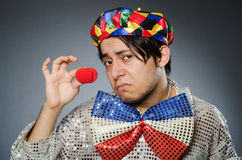Funny clown against dark background Stock Photography
