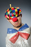 Funny clown against dark background Royalty Free Stock Image