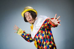 The funny clown against dark background. Funny clown against dark background Royalty Free Stock Image