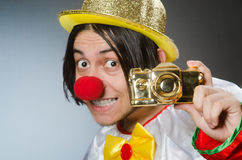 Funny clown against dark background Royalty Free Stock Photo