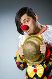 Funny clown against dark background Royalty Free Stock Photography