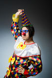 Funny clown against dark background Royalty Free Stock Photos