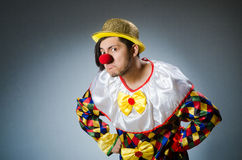 Funny clown against dark background Stock Images
