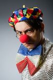 Funny clown against dark background Stock Photo