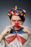 Funny clown against dark background Stock Photos