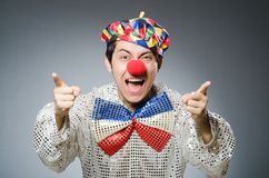 Funny clown against dark background Stock Image