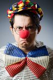 Funny clown against dark background Royalty Free Stock Images