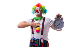 The funny clown with an alarm clock isolated on white background Stock Images