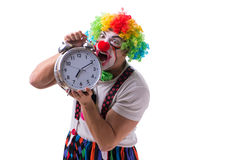 The funny clown with an alarm clock isolated on white background Stock Image