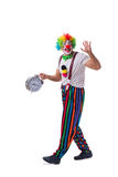 The funny clown with an alarm clock isolated on white background Royalty Free Stock Image