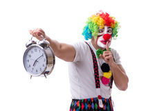 The funny clown with an alarm clock isolated on white background Royalty Free Stock Images