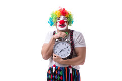 The funny clown with an alarm clock isolated on white background Stock Photography