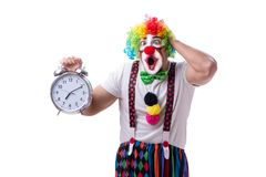 The funny clown with an alarm clock isolated on white background Royalty Free Stock Photo