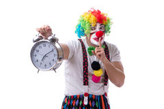The funny clown with an alarm clock isolated on white background Stock Photo