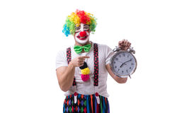 The funny clown with an alarm clock isolated on white background Stock Photos