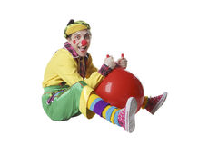 Funny clown with ball in studio isolated on white background Royalty Free Stock Photography