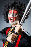 Funny clown with bat Stock Image