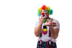 The funny clown with a birthday cake isolated on white background Stock Photos
