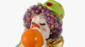 Funny clown blowing up a balloon stock footage