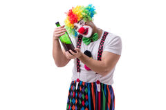 The funny clown with a bottle isolated on white background Stock Image