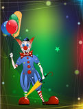 Funny clown in a bright dress. Cheerful Clown on a sparkling background Stock Photo