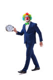 Funny clown businessman with an alarm clock isolated on white ba Royalty Free Stock Images