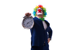 Funny clown businessman with an alarm clock isolated on white ba Royalty Free Stock Photo