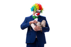 Funny clown businessman with money sacks bags isolated on white Stock Photos