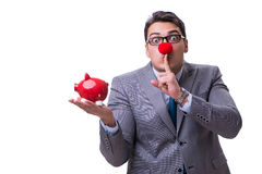 Funny clown businessman with a piggy bank isolated on white back Stock Photo