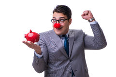 Funny clown businessman with a piggy bank isolated on white back Royalty Free Stock Images