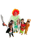 Funny clown with children in fancy dress Royalty Free Stock Image