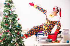 The funny clown in christmas celebration concept stock photo