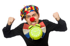 The funny clown with clock isolated on white Stock Images