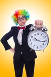 Funny clown with clock Royalty Free Stock Images