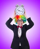 The funny clown with clock on white Royalty Free Stock Images